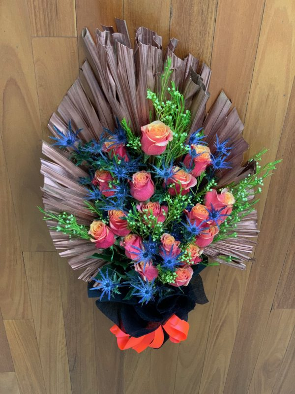 Deluxe Roses on Tinted Palm Leaf